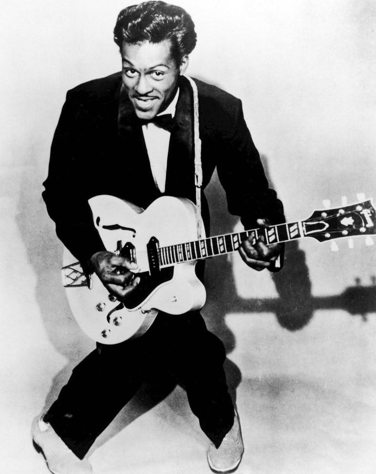 Black and white photo of Chuck Berry, with guitar, taken in 1957
