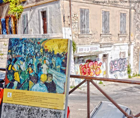 Van Gogh easel in Arles, France with graffiti in background
