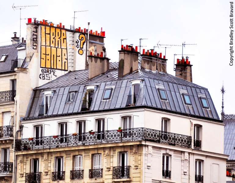 Graffiti over residential building in Paris, France