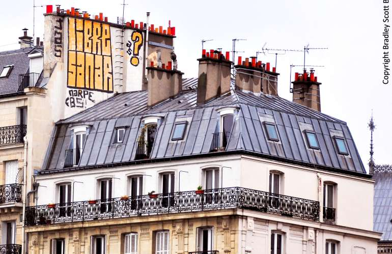 Graffiti over residential building in Paris, France
