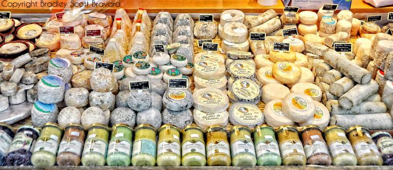 Assortment of cheeses on shelf in a market