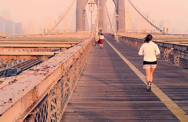 Jogger on the Brooklyn Bridge in New York City