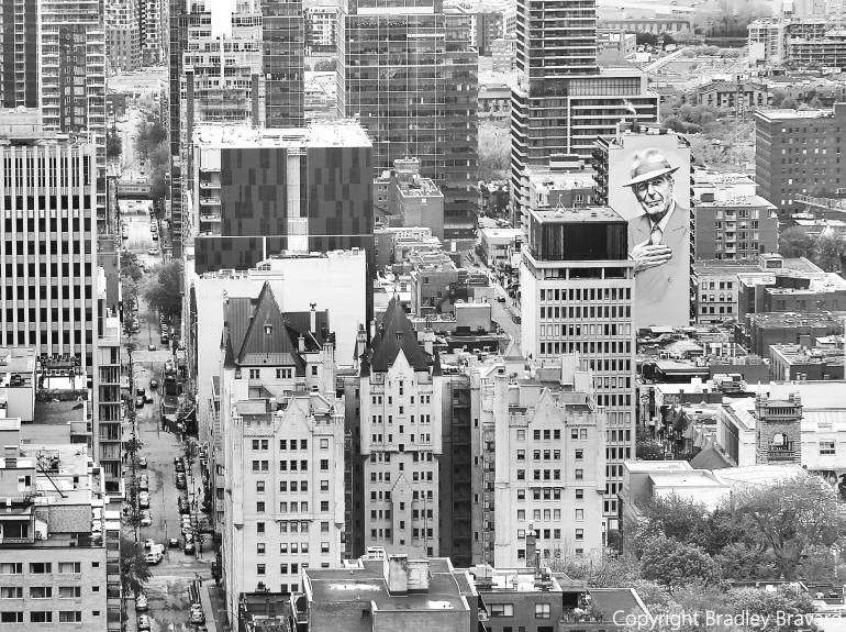 Black and white image of Montreal skyline with mural of Leonard Cohen