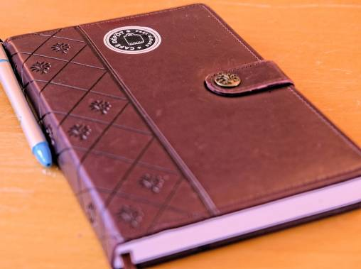 Brown leather-bound note book