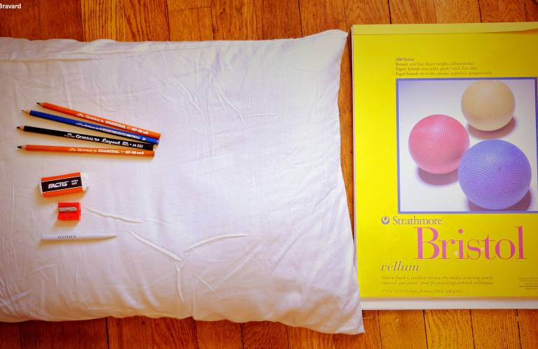 Photograph of buckwheat pillow with vellum pad and art supplies