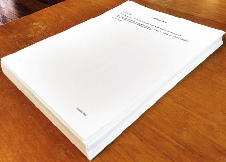 Photo of typed, printed, draft manuscript