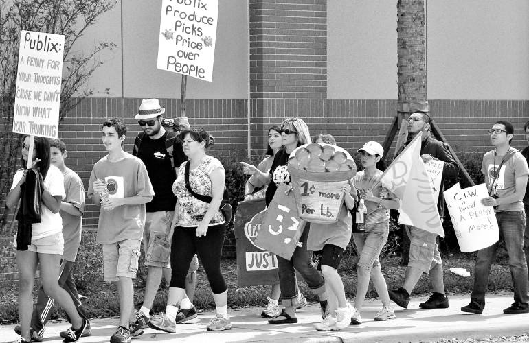 Black and white photo of demonstration for higher wages for farm workers.