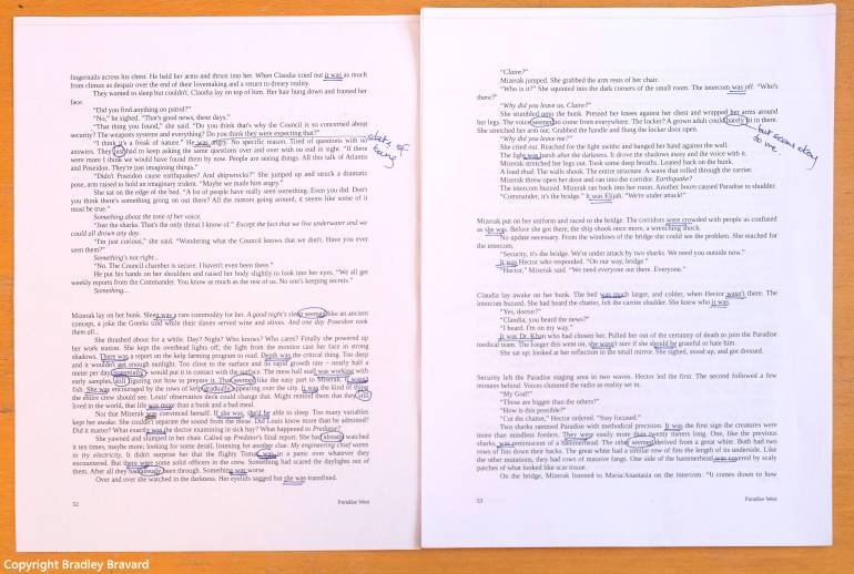 Photo of typed pages with revisions in blue ink