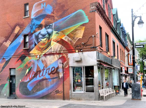 Jackie Robinson mural on brick wall of retail building in Montreal