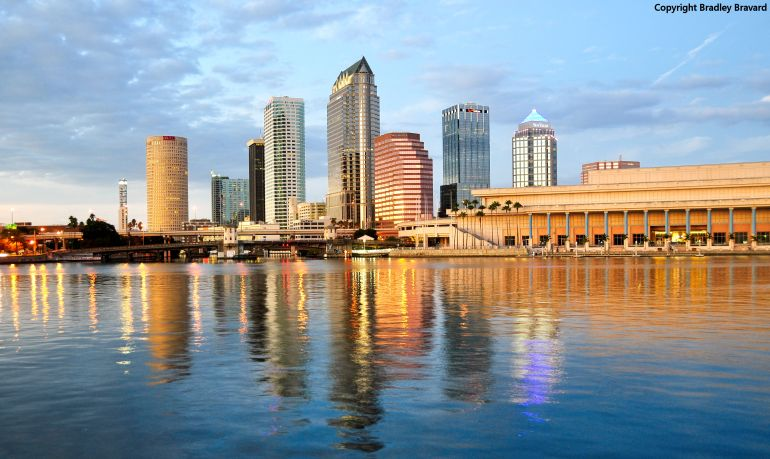 Color photo of Tampa, Florida, with skyline reflected in the Hillsborough River