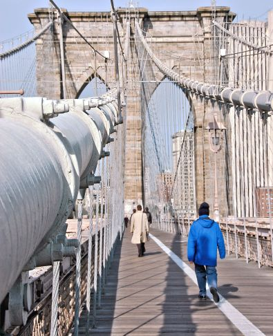 Pedestrian path on Brooklyn Bridge showing detail of suspension cable leading to bridge tower