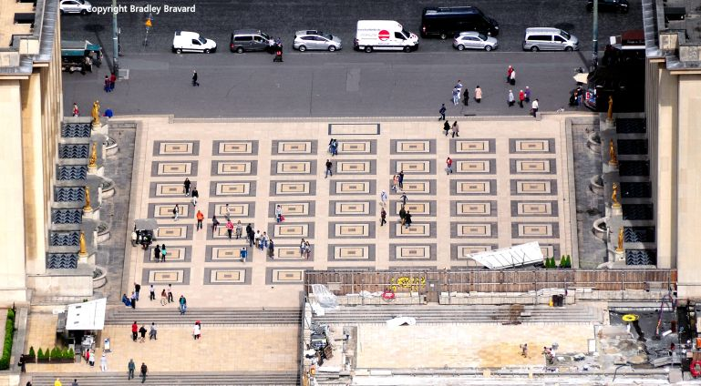 People walking along the Palais de Chaillot in Paris, photographed from the Eiffel Tower