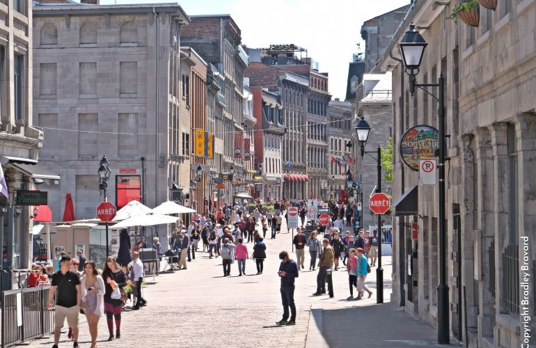 Photo of busy pedestrian shopping plaza in old town Montreal