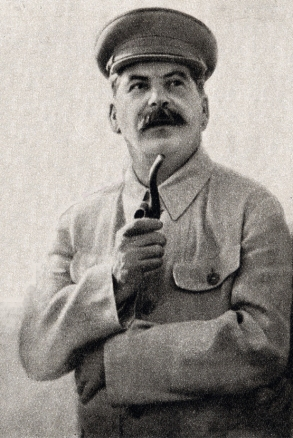 Black and white photo of Joseph Stalin holding a pipe