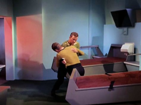 "Screenshot from Star Trek episode ""The Enemy Within"" showing good Kirk and bad Kirk in combat"