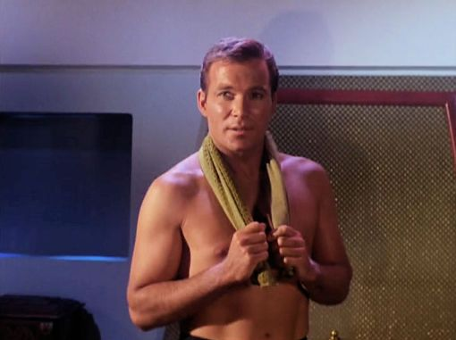 "Screenshot from Star Trek episode ""The Enemy Within"" showing Kirk without shirt"