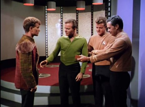 Image from Star Trek episode Charlie X with Charlie, Kirk, and officers from Antares starship