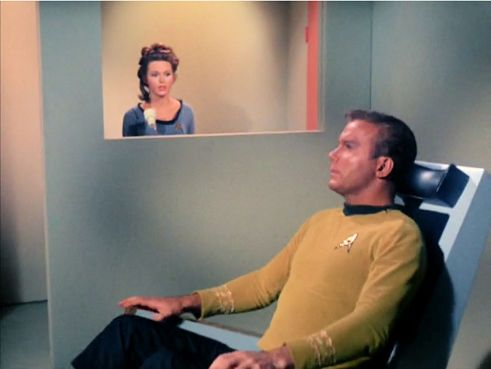 Image from Star Trek episode Dagger of the Mind showing Noel and Kirk in the neural neutralizer