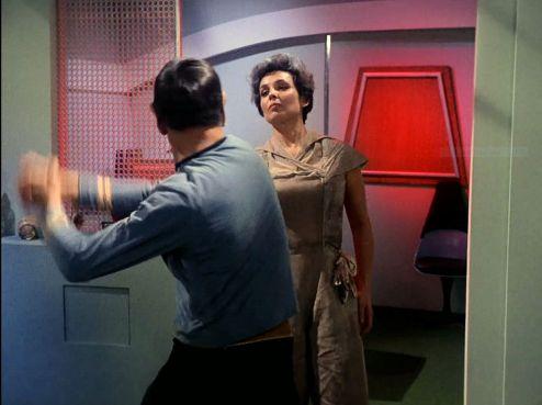 Image from Star Trek episode The Man Trap showing Spock striking salt vampire in form of Nancy Crater