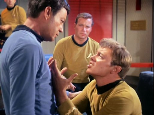 Image from Star Trek episode The Corbomite Maneuver showing, left to right, McCoy, Kirk, and Bailey on Enterprise bridge