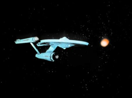 Image from Star Trek episode The Corbomite Maneuver showing Enterprise in front of space cube