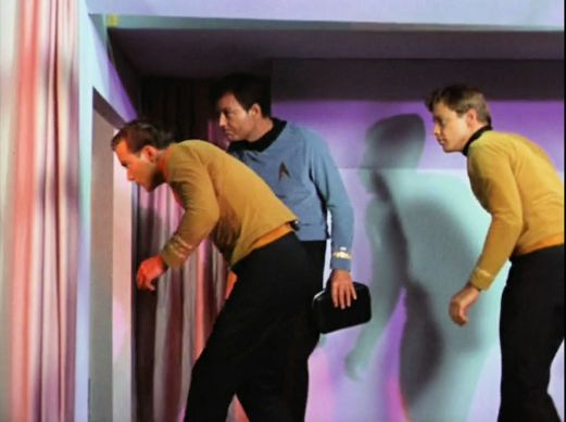Image from Star Trek episode The Corbomite Maneuver showing, left to right, Kirk, McCoy, and Bailey on Balok's ship