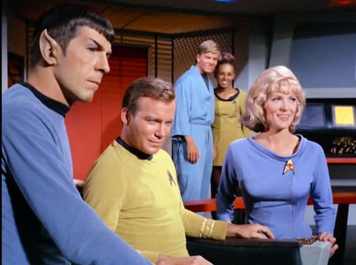 Image from Star Trek episode What Are Little Girls Made Of showing Spock, Kirk, 2 unidentified crew members, and Chapel