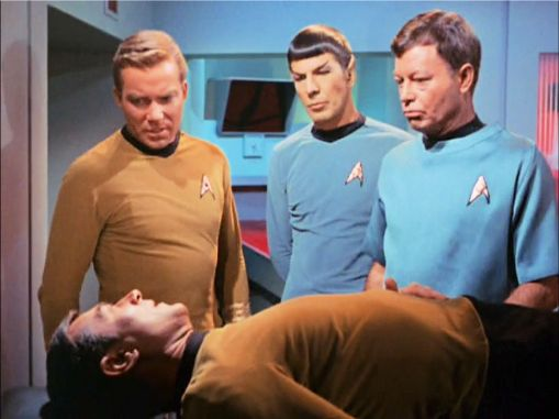 Image from Star Trek episode Balance of Terror showing Kirk, Spock, McCoy standing and Stiles on sickbay bed