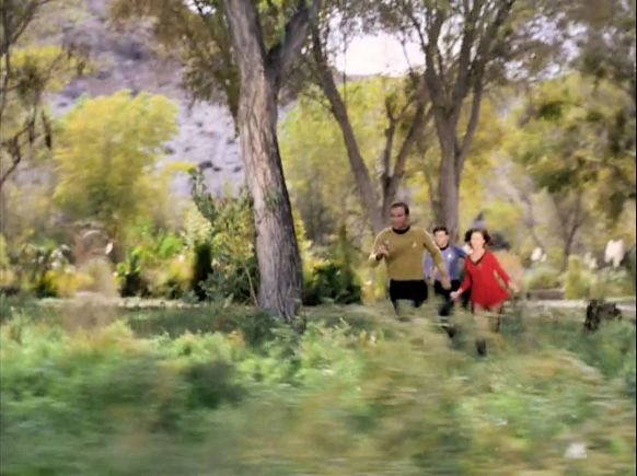 Image from Star Trek episode Shore Leave of Kirk, McCoy, and Barrows running across field on shore leave planet