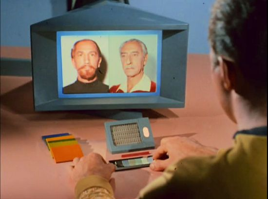 Image from Star Trek episode The Conscience of the King showing Kirk looking at photos of younger and older Karidian