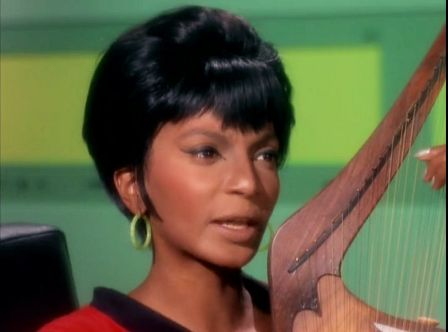 Image from Star Trek episode The Conscience of the King showing Uhuru singing and playing a lyre