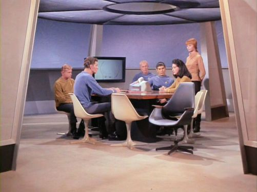 Image from Star Trek episode The Menagerie showing Number One leading meeting of officers on Enterprise
