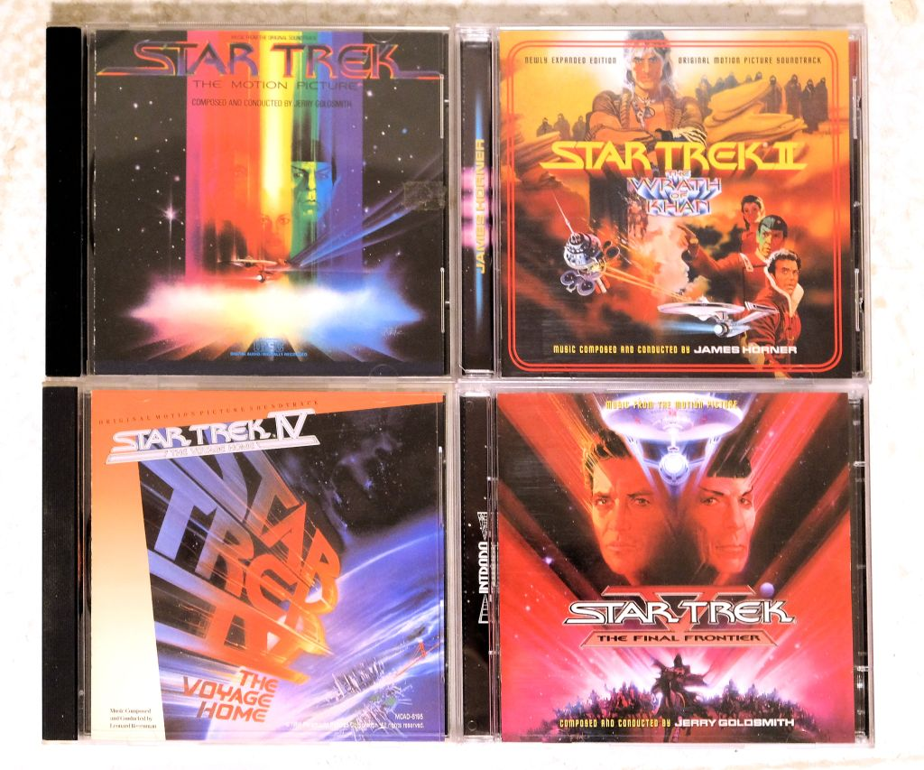 CD covers for soundtrack albums from Star Trek: The Motion Picture, Star Trek II, Star Trek IV, and Star Trek V.