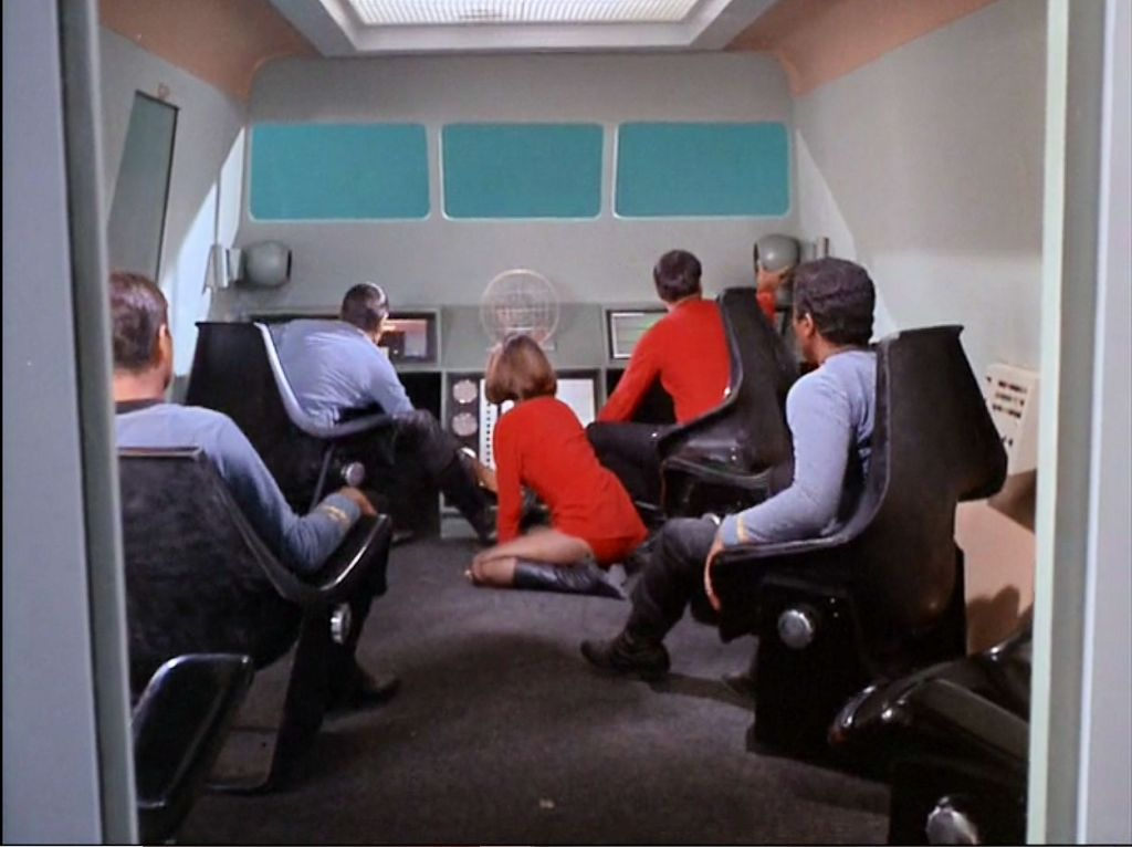 Image from Star Trek episode The Galileo Seven with Yeoman Mears on floor of shuttlecraft and male crew members in chairs